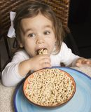 Girl eating cereal. Royalty Free Stock Photos