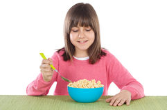 Girl eating cereal Royalty Free Stock Image