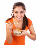 Girl eating cereals Royalty Free Stock Image
