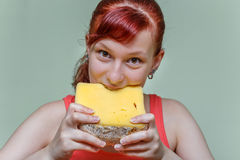 girl eating cheddar cheese Stock Photo