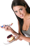 Girl eating berry topped cheesecake sweet dessert. Pretty teen girl eating cheesecake with berries Stock Images