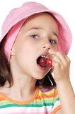 Girl eating cherries Royalty Free Stock Images