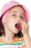 Girl eating cherries Royalty Free Stock Images