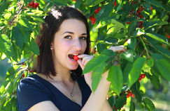 Girl eating cherry Stock Image