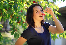Girl eating cherry Stock Photos