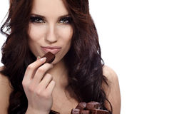 Girl eating a chocolate Stock Photo
