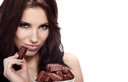 Girl eating a chocolate. Candy Stock Photography