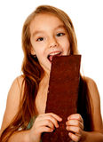 Girl eating chocolate Stock Photo