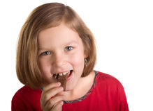 Girl eating chocolate. Isolated on white background Stock Images