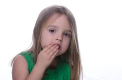 Girl eating chocolate. Girl enjoying the last of a chocolate bar Stock Image