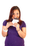 Girl eating chocolate. Royalty Free Stock Photography