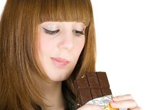 Girl eating chocolate Stock Image