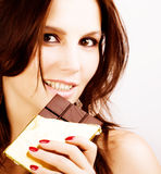 Girl eating chocolate Royalty Free Stock Photography