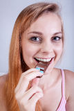 Girl eating chocolate bar Stock Images