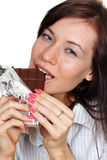 Girl eating a chocolate Stock Photos