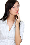 Girl eating a chocolate candy. In studio Royalty Free Stock Image