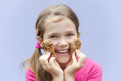 Girl eating chocolate cookies Stock Photo