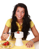 Girl eating chocolate fondue Royalty Free Stock Photography