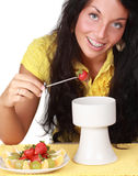 Girl eating chocolate fondue Stock Photography
