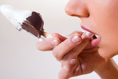 Girl eating chocolate ice cream Royalty Free Stock Images