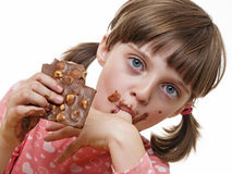 Girl eating a chocolate Stock Images