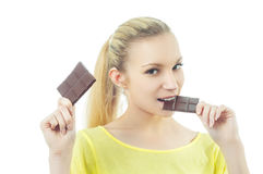Girl eating chocolate Royalty Free Stock Image