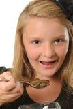 Girl eating coins Royalty Free Stock Photos