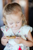 Girl eating cookie Royalty Free Stock Photography