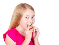 Girl eating cookie Stock Photos