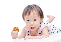 Girl eating cookie . Royalty Free Stock Photography