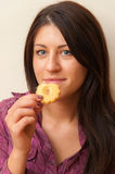 Girl Eating Cookie Stock Photo