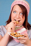 Girl eating cookies Royalty Free Stock Photo