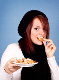 Girl eating cookies Stock Photo