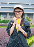 Girl eating corn Stock Images
