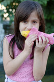 Girl eating corn on the cob Royalty Free Stock Image