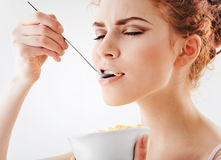 Girl eating corn flakes Stock Photo