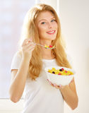 Girl eating corn flakes Royalty Free Stock Photo
