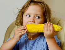 Girl eating corn Royalty Free Stock Image