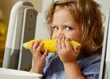 Girl eating corn Royalty Free Stock Photos