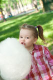 Girl eating cotton candy Royalty Free Stock Photography