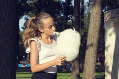 Girl eating cotton candy Stock Image