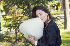Girl eating cotton candy Royalty Free Stock Image