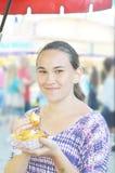 Girl Eating Crab Ragoon royalty free stock images
