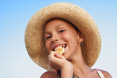 Girl eating cracker Royalty Free Stock Images