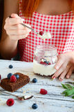 Girl eating creamy dessert in a jar Stock Photo