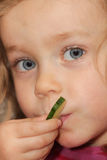 Girl eating cucumber Royalty Free Stock Photography