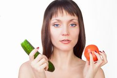 Girl eating cucumber Stock Photo