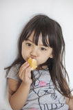 Girl eating custard cake royalty free stock photography