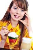 Girl eating dessert Stock Photos