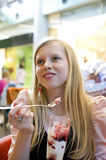 Girl eating a dessert Royalty Free Stock Photos